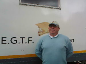 John Dunphy in front of lorry